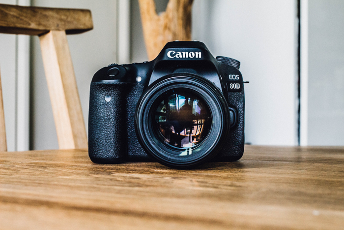 A Canon DSLR resting on a table - lens calibration