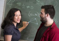 woman and male using blackboard to do equations