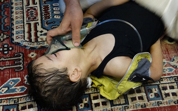 A boy, affected by what activists say is nerve gas, breathes through an oxygen mask in Damascus in August 2013