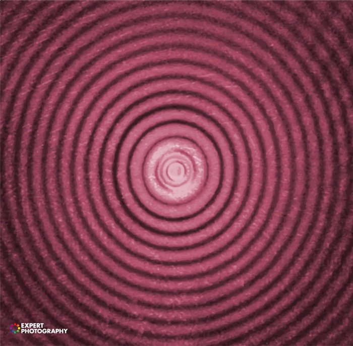 Pink toned concentric circles - what is lens diffraction