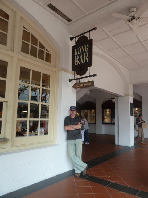 At the entrance to the Long Bar, Raffles Hotel, Singapore