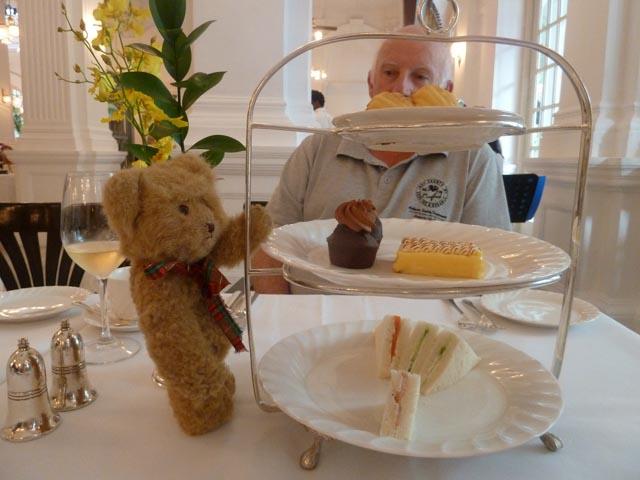 Hamish helping to eat High Tea at Raffles