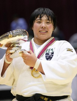 Akira Sone is pictured with her trophy after capturing her second straight Japan women's national judo championship title. (Kyodo)