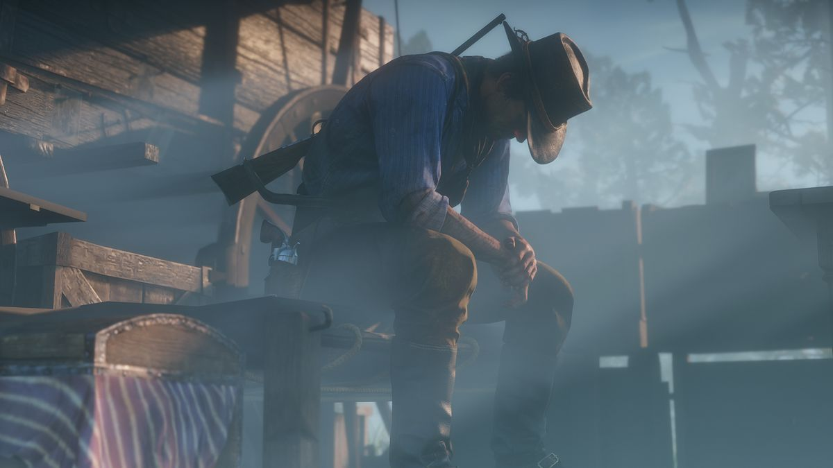 Red Dead Redemption 2 - Arthur sits by his wagon, contemplating what he has done