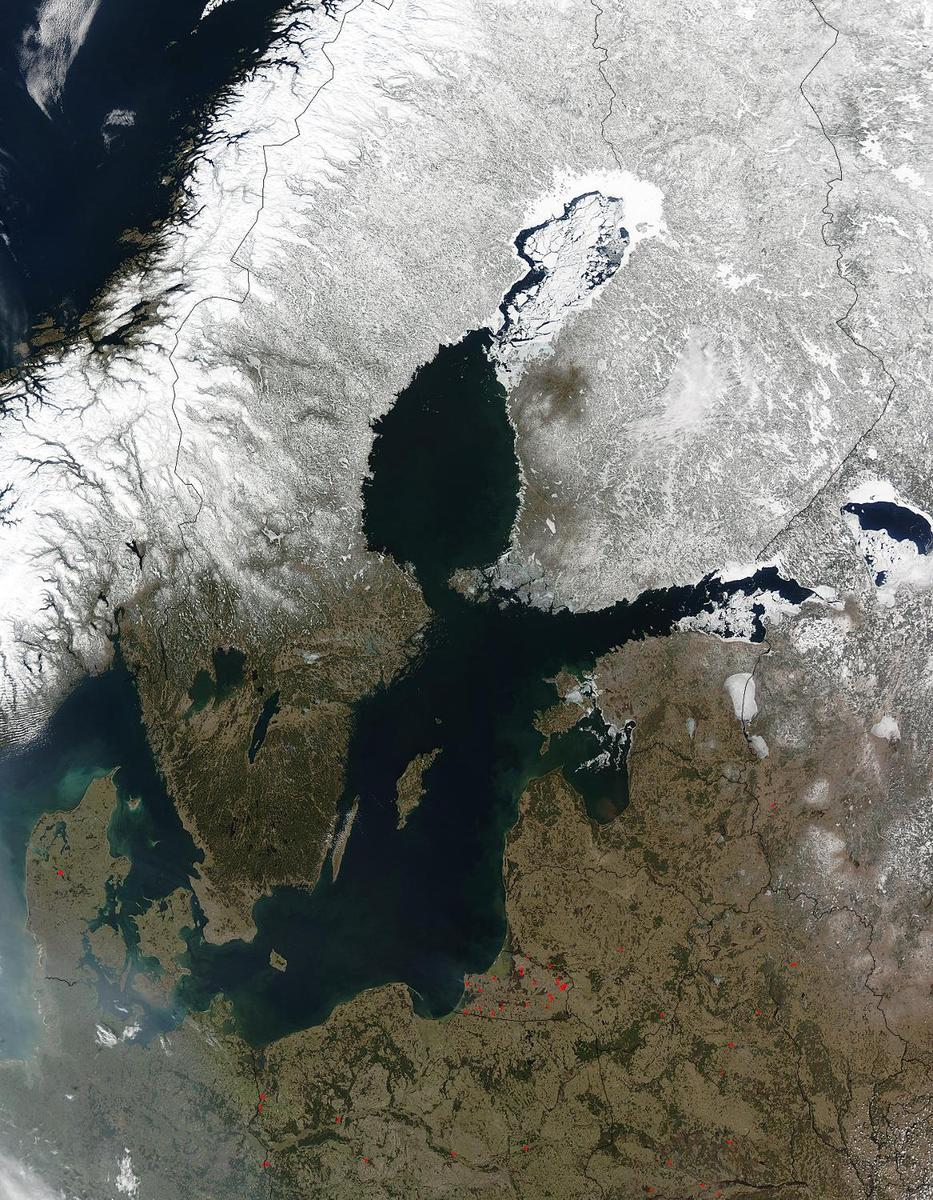 Red dots mark the locations of fires burning in countries south and east of the Baltic Sea in this early April image. The scattered fires were probably set to clear land for agricultural purposes. The Scandinavian countries, Norway and Sweden, and Finland to the north of the Sea, are still blanketed in snow. From the left, the countries lining the Baltic on the south are Denmark, Germany, Poland, Russia (Kaliningrad), Lithuania, Latvia, Estonia, and Russia. Belarus forms the lower right corner of the image. Photo courtesy of NASA.