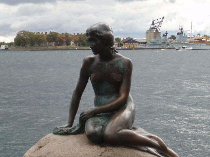 The Little Mermaid statue in Copenhagen Harbor has been a symbol of the city since 1913. Based on the fairy tale of the same name by Danish author Hans Christian Andersen, the small, unimposing, bronze statue has been damaged or defaced many times in the past half century, but has always been restored.