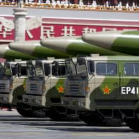 Chinese military vehicles carrying DF-26 ballistic missiles travel in Beijing's Tiananmen Square during a military parade to commemorate the 70th anniversary of the end of World War II on Sept. 3, 2015.