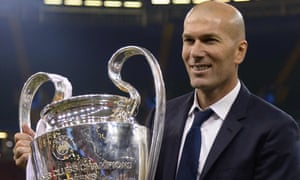 Real Madrid's coach, Zinedine Zidane, lifts the trophy after his side won the Champions League
