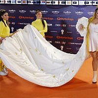 Israel's Netta Barzilai, the winner of last year's Eurovision contest, poses for a picture during the Orange Carpet ceremony of the 64th edition of the Eurovision Song Contest 2019, at Expo Tel Aviv, on May 12, 2019. (Jack GUEZ / AFP)