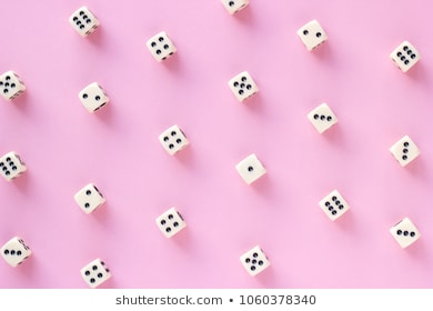 Gaming dice pattern on pink background in flat lay style. Concept for games, game board, presentation, banners or web. Top view. Close-up.