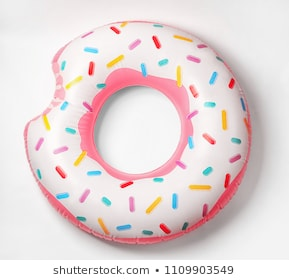Bright inflatable donut on white background. Beach object