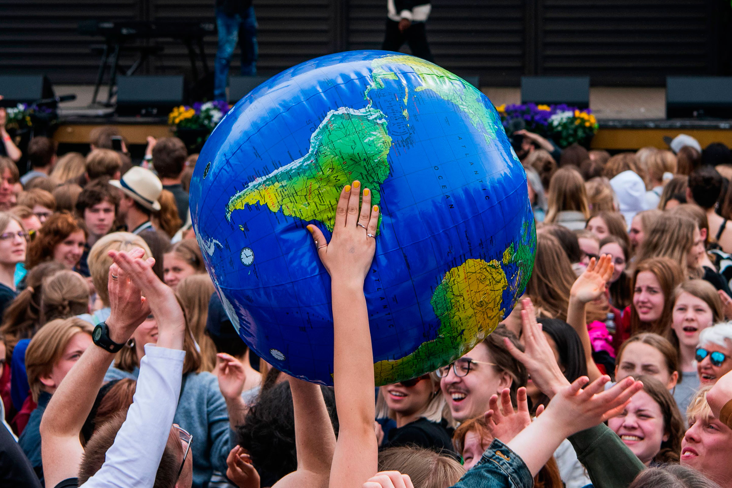 Protesters throw an earth-shaped ball during the  Global Strike For Future  demonstration in Stockholm on May 24, 2019.