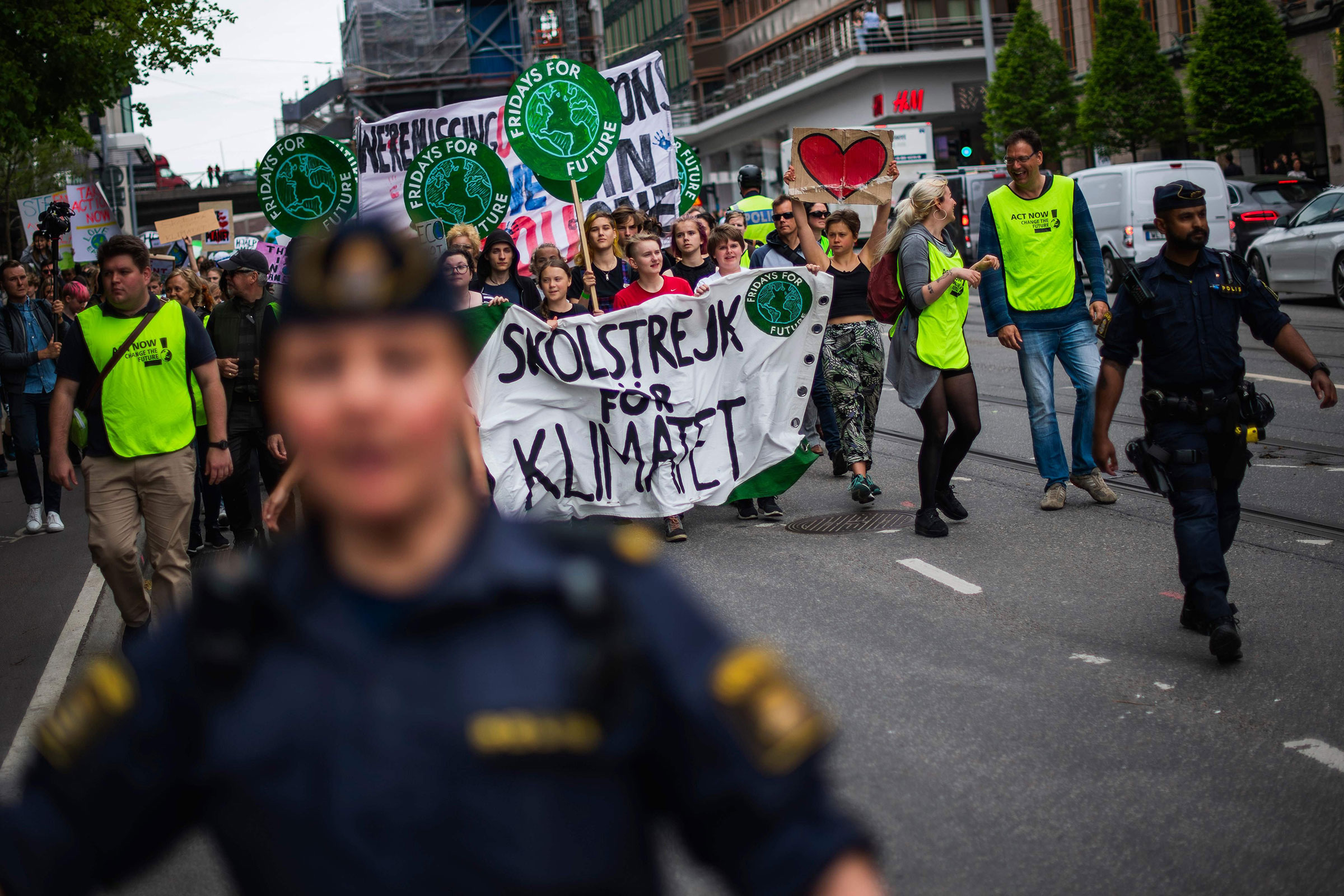 Greta Thunberg (2ndL behind the banner), the 16-year-old Swedish climate activist, marches during the  Global Strike For Future  movement on a global day of student protests aiming to spark world leaders into action on climate change in Stockholm, Sweden on May 24, 2019.