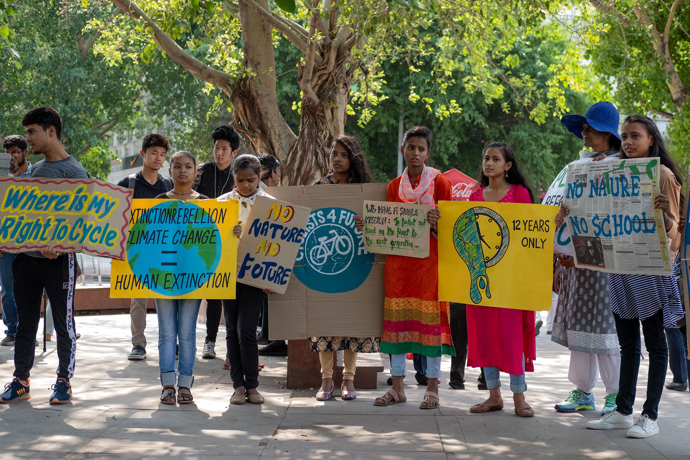 Indian students and school children hold placards as they participate in a global strike for urgent climate action in New Delhi on May 24, 2019.