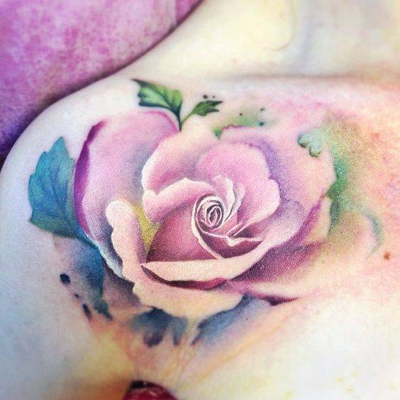 Tattoo on the clavicle at the girl - rose