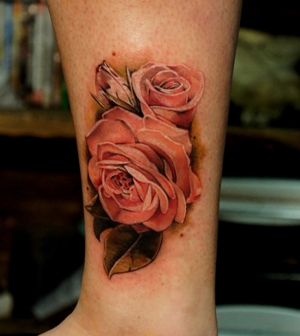 Tattoo on shin of the girl - the roses