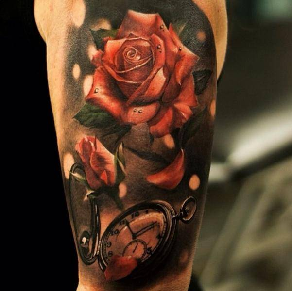 Tattoo on the shoulder of a man - rose and clock
