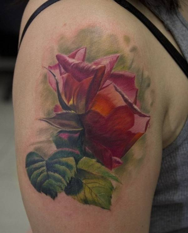 attoo on the shoulder of the girl - rose