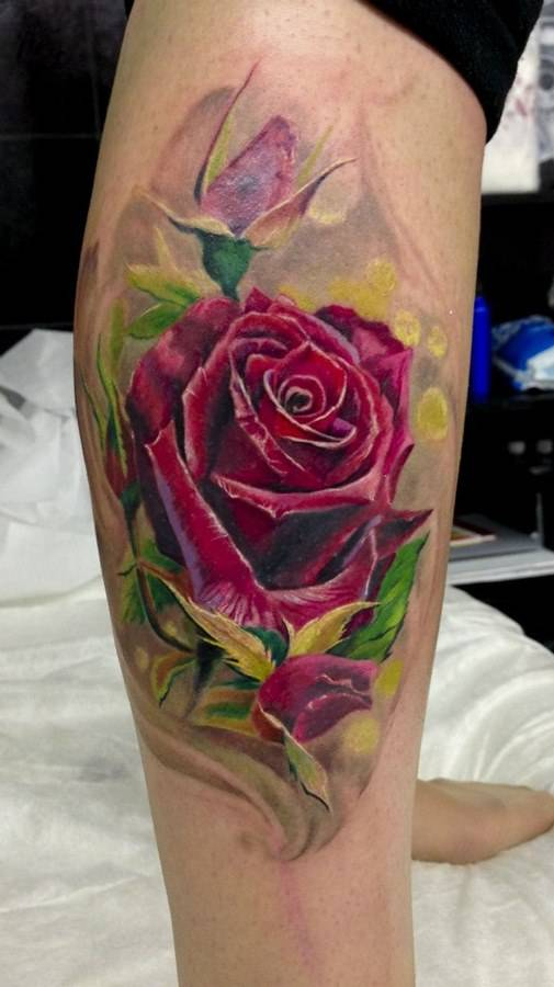 Tattoo on the lower leg of the girl - rose