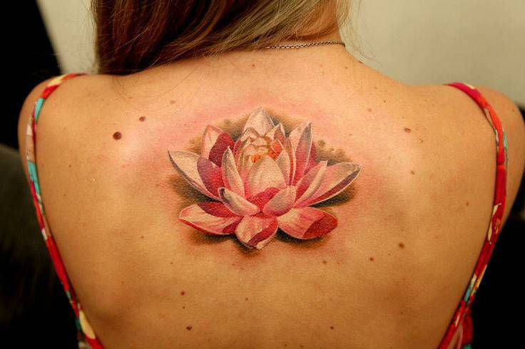 Tattoo on the spine of the girl - Lotus