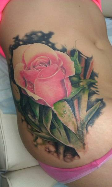 Tattoo on the side of the girls - pink rose