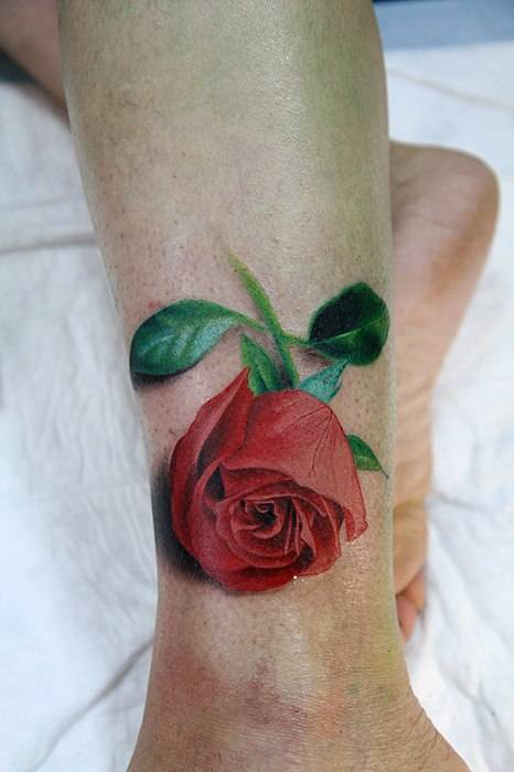 Tattoo on shin of the girl - red rose
