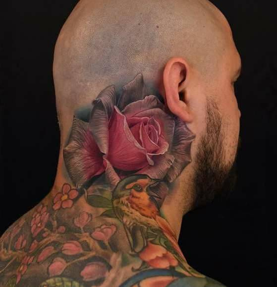Tattoo on the neck of a man - rose