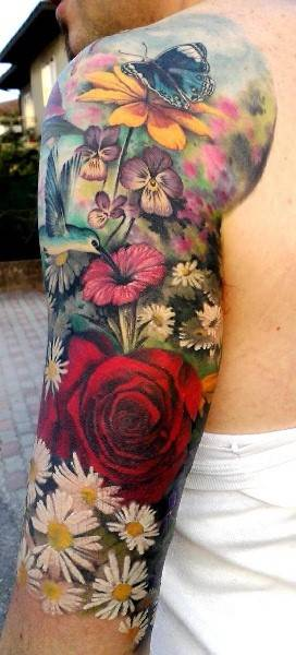 Tattoo on the arm of a man - rose and other flowers