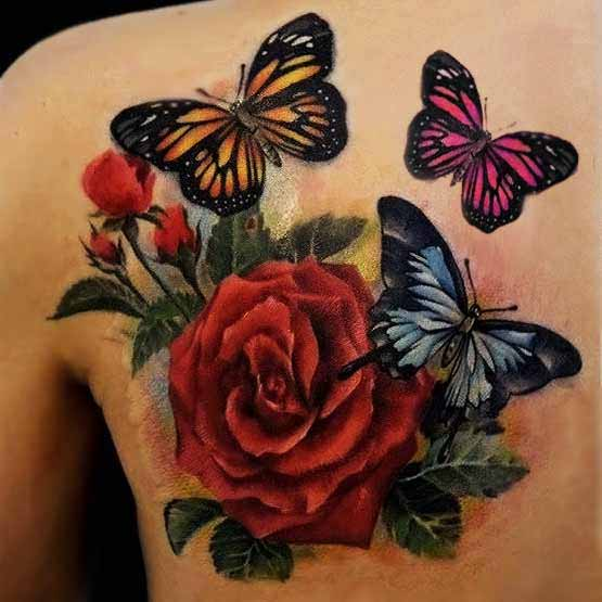 Tattoo on the blade of the girl - red rose and butterflies