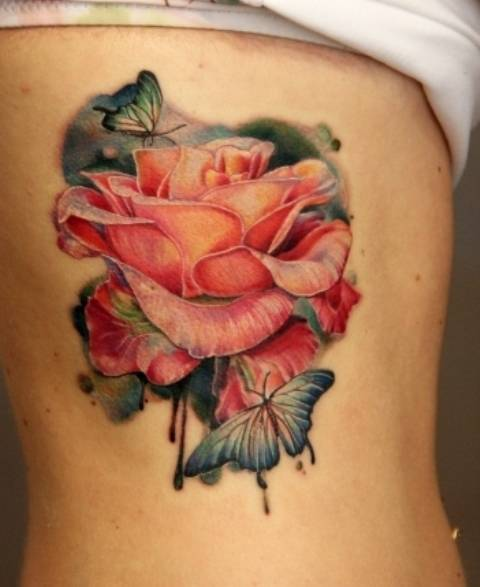 Tattoo on the edges of the girl - rose and butterflies