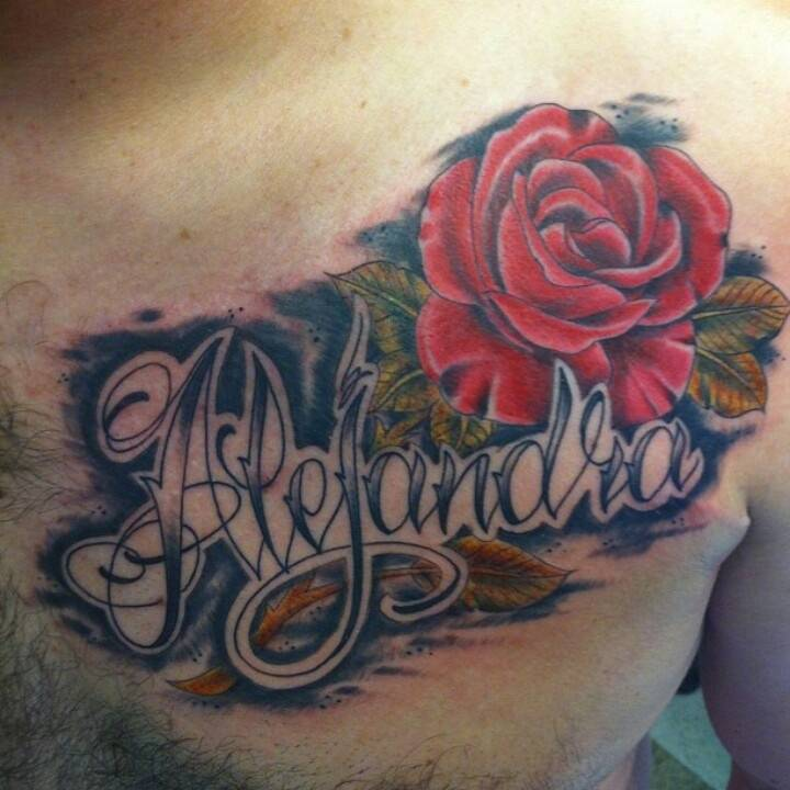 Tattoo on the chest of a man - rose and name
