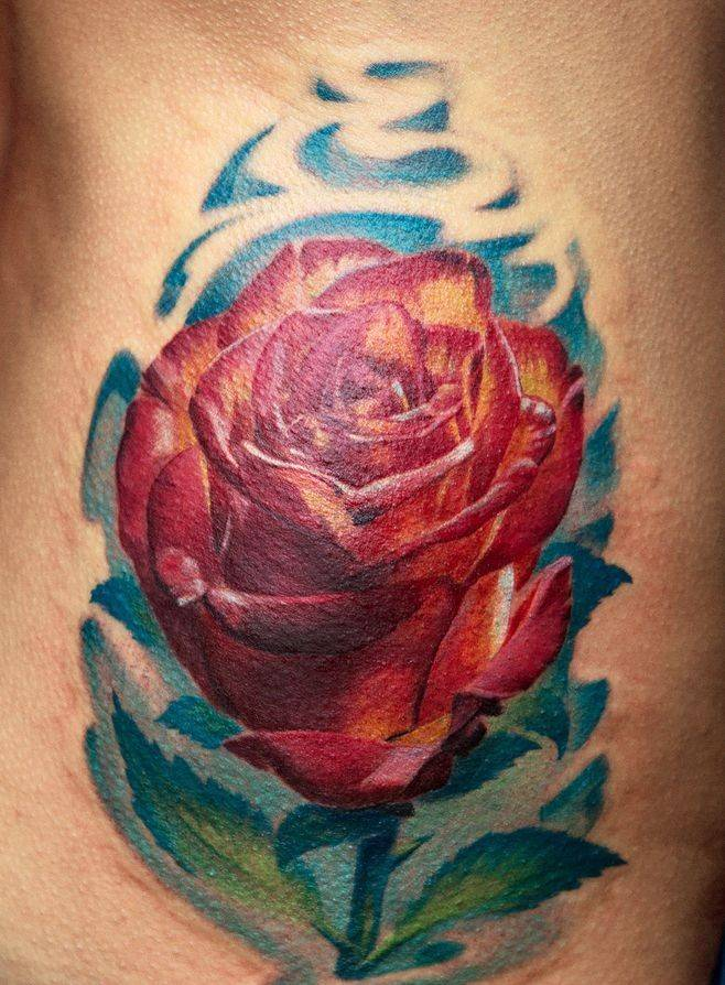 Tattoo on the side of the girl - red rose