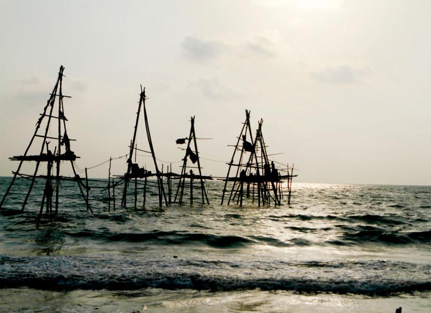Locals set up makeshift oil rigs at the Kyaukphyu shoreline in 2014. Photo - EPA