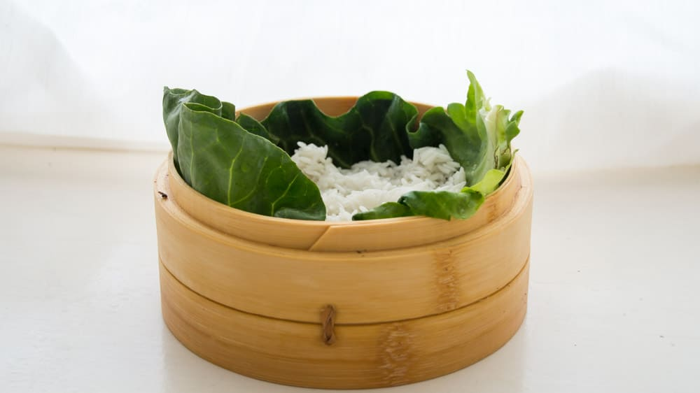 bamboo steamer -Cabbage leaf and soaked basmati rice