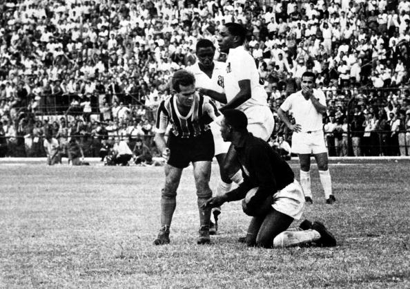 Football, Sao Paulo, Brazil, 1957, Legendary Brazilian footballer Pele pictured making a save as a seventeen year old when he was a goalkeeper in the Brazilian league  (Photo by Paul Popper/Popperfoto/Getty Images)