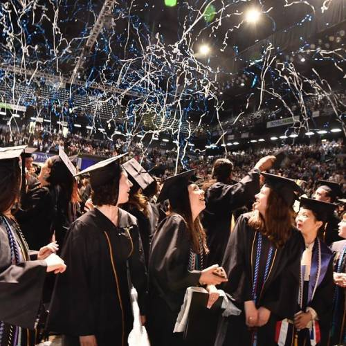 Colorful streamers fall from the ceiling at the end of JHU's 2019 graduation ceremony