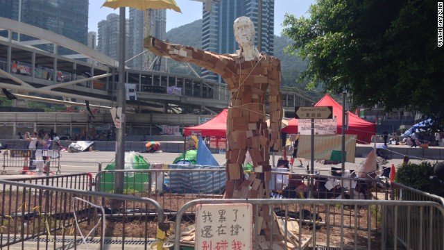 """The statue """"Umbrella Man,"""" by the Hong Kong artist known as Milk, stands at a pro-democracy protest site in the Admiralty district on October 6."""