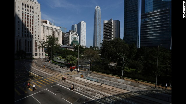 People walk to work on a main road in the occupied areas of Hong Kong on October 6.