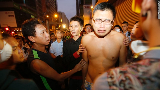 Pro-democracy protesters break down as riot police clear their camp October 17.