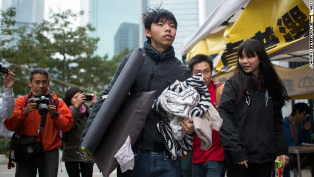 Student protest leader Joshua Wong carries his belongings toward a tent at the main protest site in Hong Kong's Admiralty district on Tuesday, December 2. Wong and two other student demonstrators have begun a hunger strike to demand discussions with Hong Kong's leaders over political reform for the city.