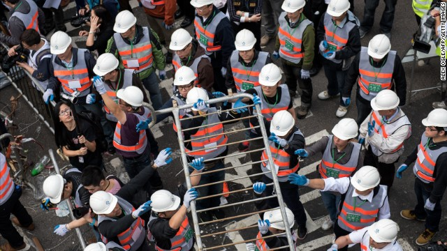 Authorities dismantle a barricade December 11 at the main protest site.