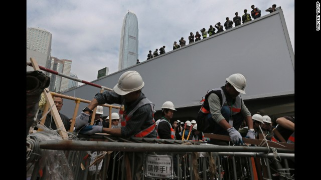 Workers clear barricades on December 11. Protesters wanted to pressure the government to allow open elections for Hong Kong's chief executive in 2017.