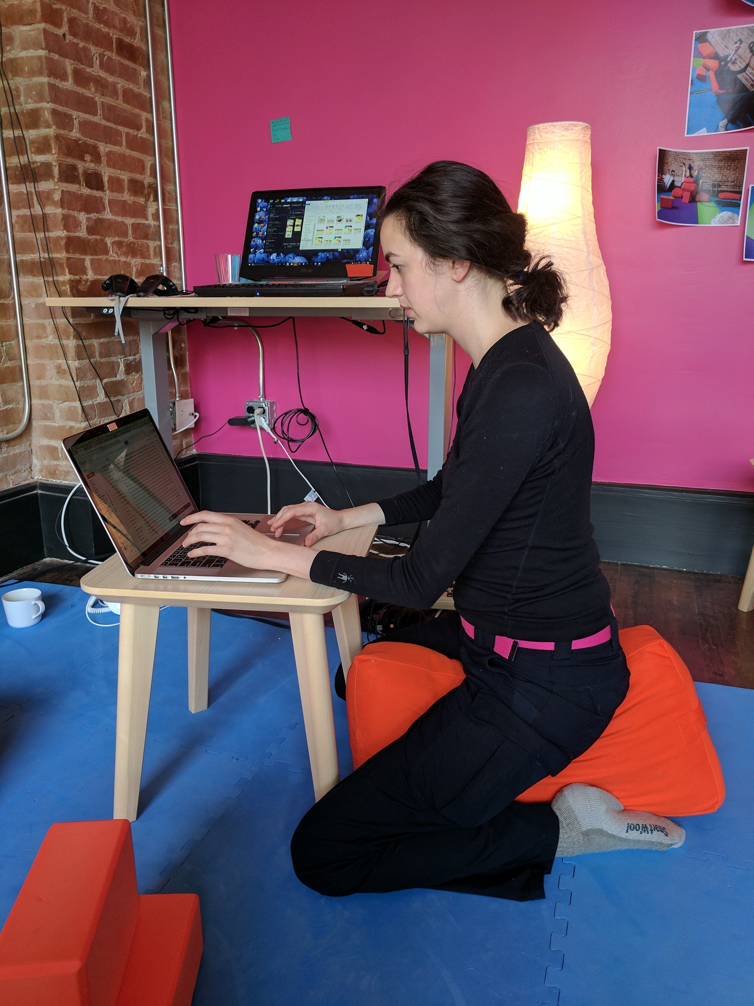 Sitting with a cushion between your bent knees may work better for humans who find cross legged sitting uncomfortable (even elevated as in previous pictures).
