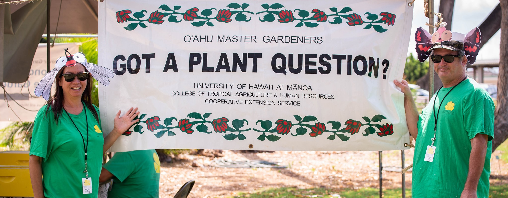 CTAHR Master Gardeners holding a banner reading Got a Plant Question?