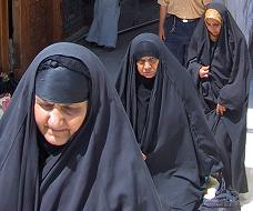 Shi'is coming out of a Shi'i shrine in Karbala, Iraq.