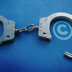 Handcuffs with copyright symbols inside the cuffs.