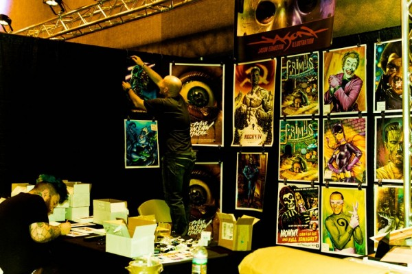 Jason Edmiston setting up his MondoCon booth | photo by Holly Burnham