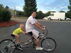 Riding a tandem bike with son