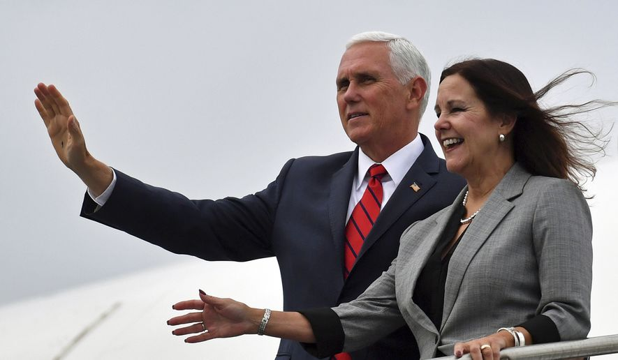 U.S. Vice President Mike Pence and his wife Karen Pence arrive at Shannon airport from Dublin during an official visit to Ireland, Tuesday Sept. 3, 2019. Pence said Tuesday during a visit with Irish Prime Minister Leo Varadkar in Dublin on Tuesday that the United States supports Britain's decision to leave the European Union and wants to see negotiations succeed. (Jacob King/PA via AP)