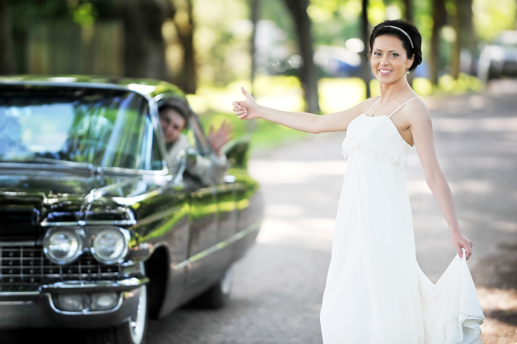 bride thumbing a ride from groom